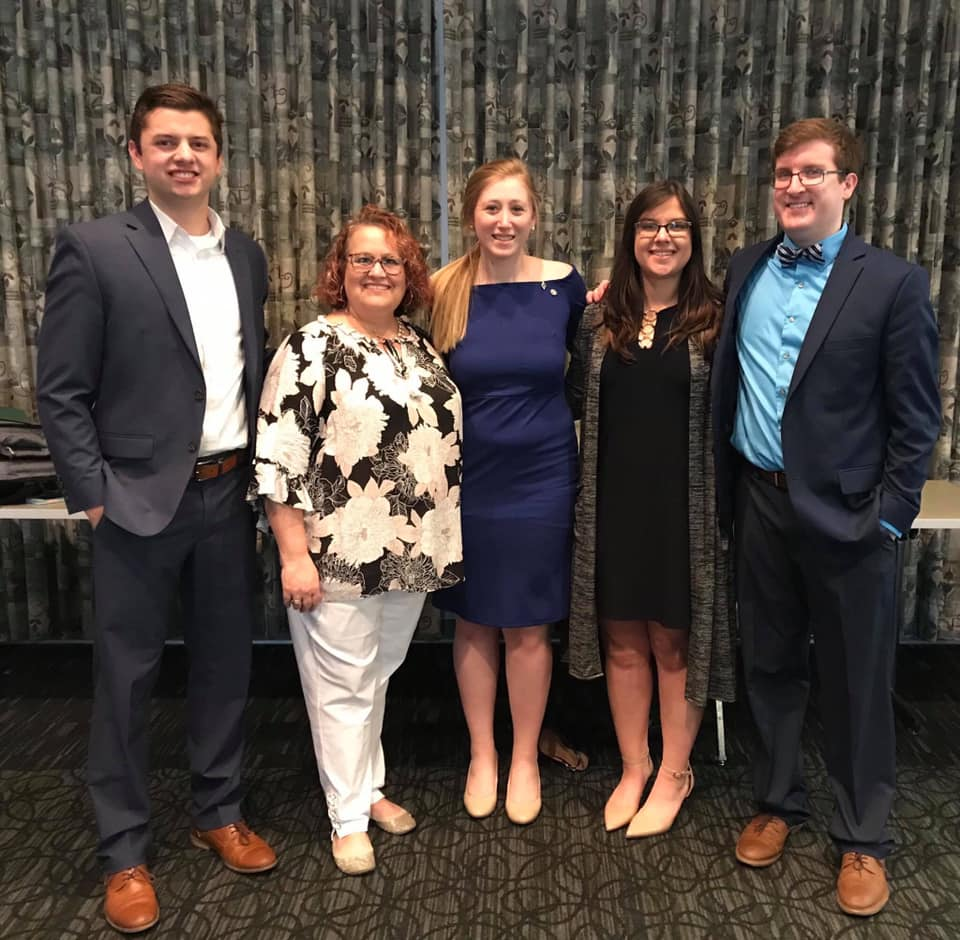 Gina Keucher, Greek Life Advisor, with three of our past FSC Presidents, as well as our next FSC President. / Photo provided by Sarah Christy