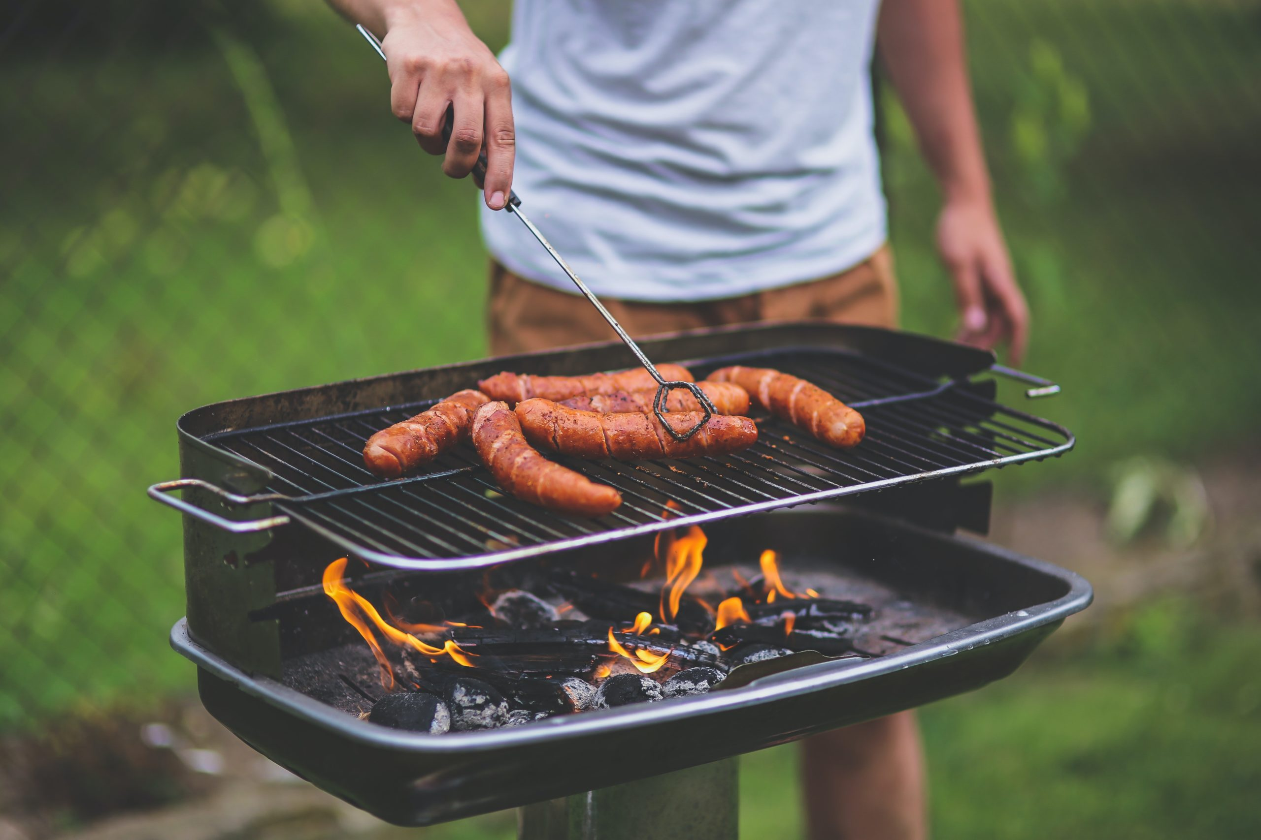 Man grilling | Photo by Kaboompics on Pexels