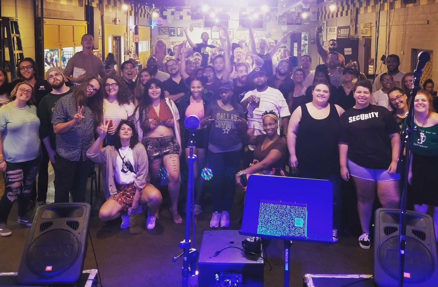 group photo of a poetry slam event
