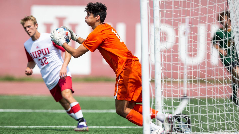 WSU Men's Goalie catching soccer ball